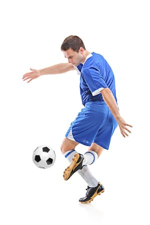 Football player with ball isolated against white background Stock Photo - 6147387