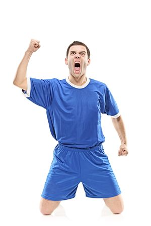 Soccer player screaming isolated against white background photo