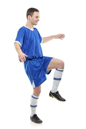 Soccer player isolated against white background Stock Photo - 6279435