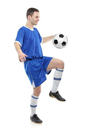 plimsoll: Soccer player with a ball isolated against white background Stock Photo