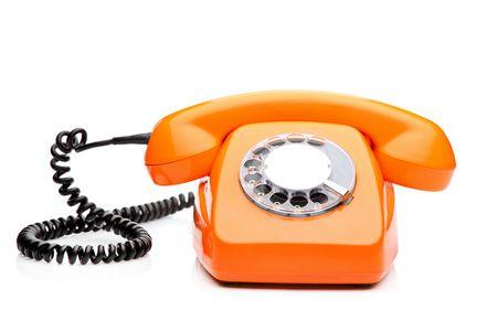 A retro orange phone isolated on white background photo