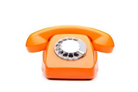 antique telephone: An old orange phone isolated on white background Stock Photo