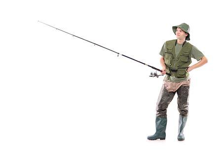 fishingpole: A young fisherman waiting isolated on white background