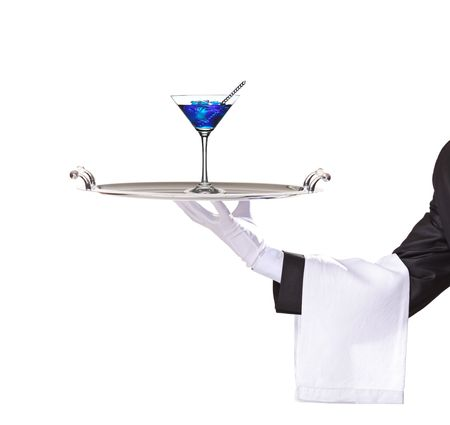 silver tray: A butler holding a tray with cocktail blue curacao on it isolated on white Stock Photo