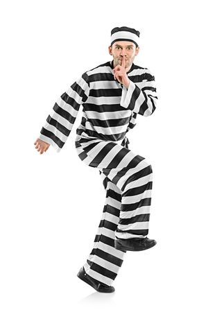 convicted: Prisoner escaping isolated on white background Stock Photo