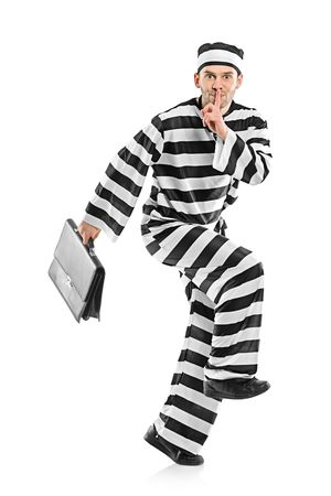 fraudster: Prisoner stealing a briefcase isolated on white background Stock Photo