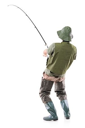 angler: A young euphoric fisherman isolated on white background Stock Photo