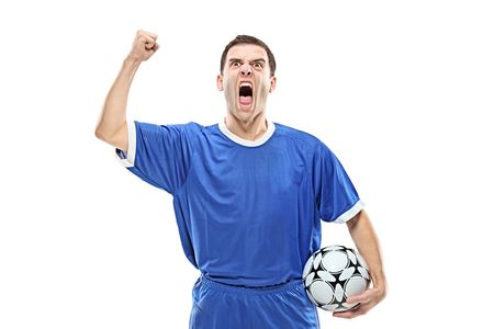 Soccer player with a ball screaming isolated against white background