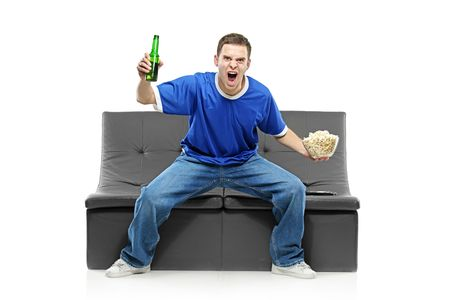 Excited man watching sport isolated on white background photo