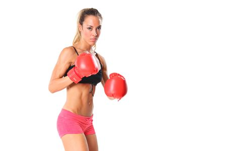 Beautiful young woman with red boxing gloves isolated on white background photo