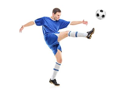 plimsoll: A soccer player shooting a ball isolated on white background