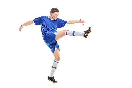 plimsoll: A soccer player shooting isolated on white background