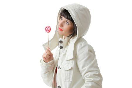 Beautiful girl with a lollipop isolated on white background photo