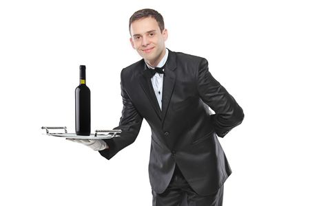 Young person holding a tray with a red wine on it isolated on white background photo