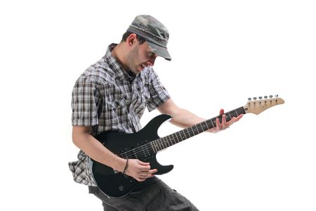 rockstar: Guitar player jumping in midair isolated against white background