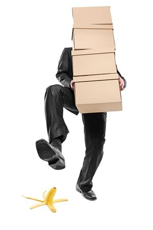 Person with paper boxes about to step on a banana peel photo