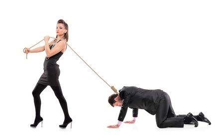 banish: A woman torturing her boyfriend isolated on white