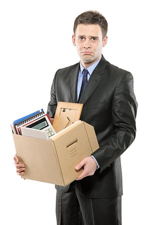 unemployed dismissed: A fired man in a suit carrying a box of personal items isolated on white