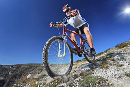 mountain biking: Person riding a bike downhill style