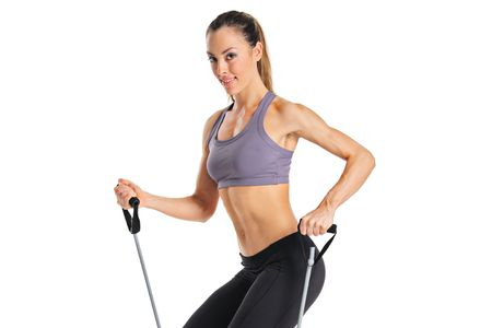 A pilates instructor with exercise bands isolated on a white background photo