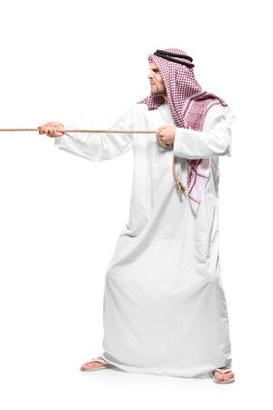 An Arab person pulling a rope isolated on white background photo