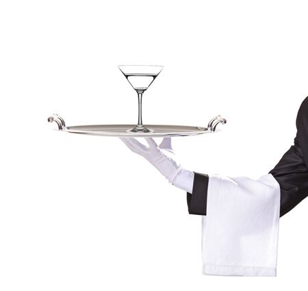 A butler holding a tray with cocktail on it isolated on white photo