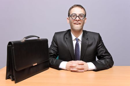 geeky: Nerdy businessman in the office