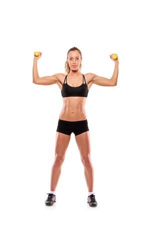 muscle strain: Young attractive woman with weights isolated on white background