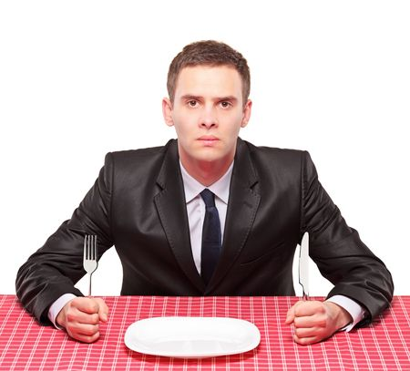 sitted: A businessman sitted on a table with an empty plate