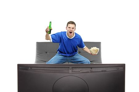 color fan: Excited man watching sport on a TV isolated on white background