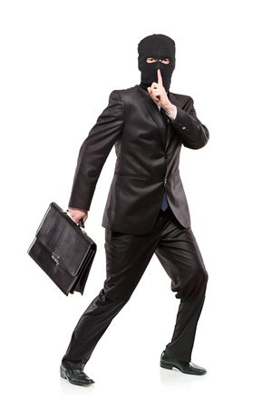 A man in robbery mask stealing a briefcase isolated on white background Stock Photo - 6766016