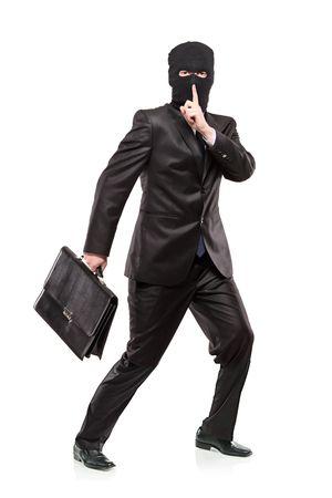 ladron: Un hombre de la m�scara de robo, robo de un malet�n aislado sobre fondo blanco Foto de archivo