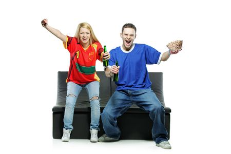 Excited man and woman watching sport isolated on white background photo