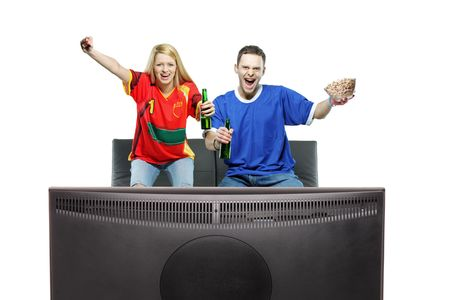 Excited man and woman watching sport on a TV isolated on white background photo