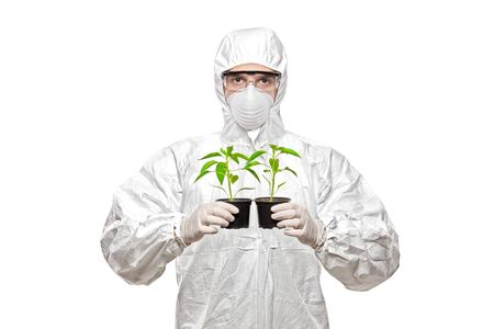 A man in uniform holding plants isolated on white background photo