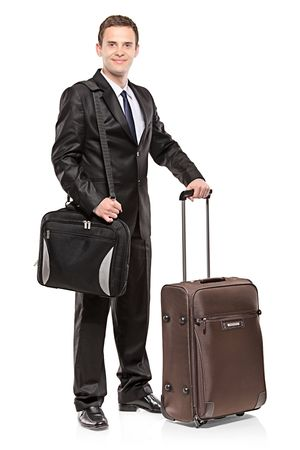 Businessman carrying his laptop in a shoulder bag and his luggage, isolated on white photo
