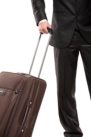 Business traveller with a suitcase isolated on white background (focus on the suitcase) photo