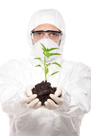peper: A man in uniform holding a peper plant isolated on white background