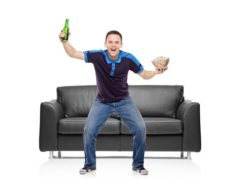 kibitz: Sport fan with a beer bottle and popcorn bowl in his hands isolated on white background