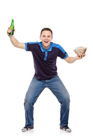 Sport fan with a beer bottle and popcorn bowl in his hands isolated on white background Stock Photo - 6971051