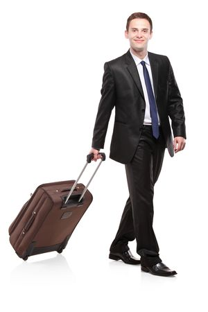 wayfarer: Business traveller carrying a suitcase isolated on white background
