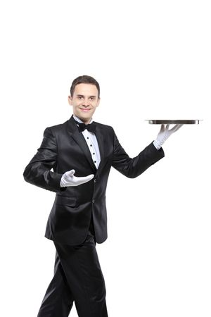 concierge: A young butler carrying a tray isolated on white background