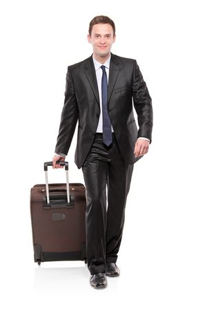 business traveler: Business traveler carrying a suitcase isolated on white background