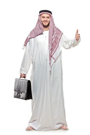 An arab person with a thumbs up isolated on white background photo