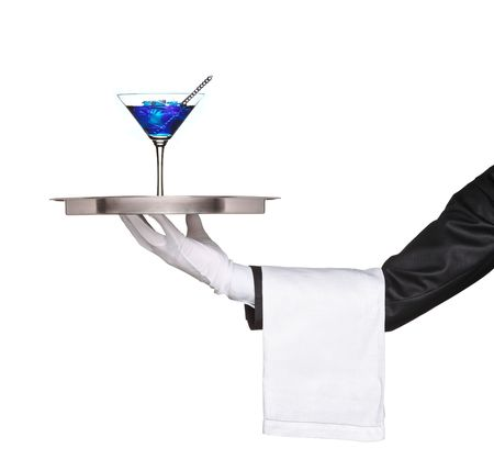 A hand holding a silver tray with a blue cocktail on it isolated on white background photo