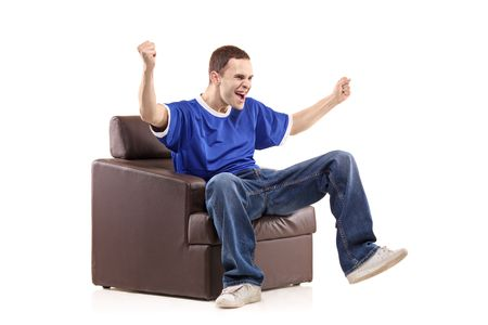 barrack: A sport fan sited in a chair isolated on white background Stock Photo