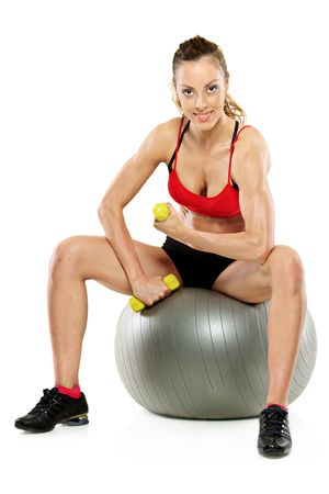 A female working out with a dumb bell isolated on white background photo