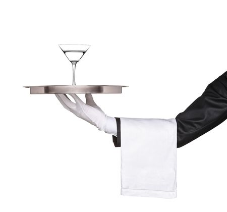 A hand holding a silver tray with a cocktail martini on it isolated on white background photo