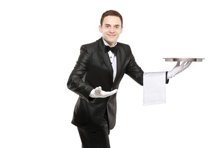 A young butler carrying an empty tray isolated on white background photo