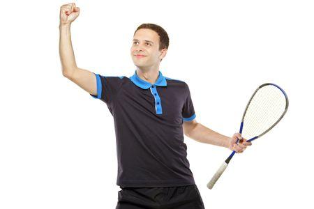 A happy squash player celebrating a score isolated on white background photo